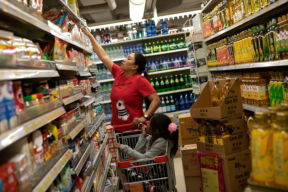 Vanessa Mae Rodel, 42, goes grocery shopping with her seven-year-old daughter Keana Nihinsa, in Hong Kong, on March 21, 2019, days ahead of their move to Canada. / Photo: Maria de la Guardia