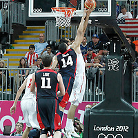 31 July 2012: USA Anthony Davis blocks Tunisia Salah Mejri during 110-63 Team USA victory over Team Tunisia, during the men's basketball preliminary, at the Basketball Arena, in London, Great Britain.