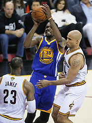 The Golden State Warriors' Kevin Durant, middle, puts a shot up against the Cleveland Cavaliers' Richard Jefferson in the second quarter during Game 4 of the NBA Finals at Quicken Loans Arena in Cleveland on Friday, June 9, 2017. (Photo by Leah Klafczynski/Akron Beacon Journal/TNS) *** Please Use Credit from Credit Field ***