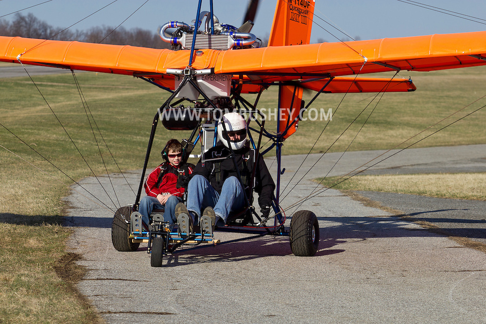 Middletown, New York - The pilot of an experimental aircraft taxis his plane back to the hangar at Randall Airport on  April 12, 2014. The MX II Sprint ultralight is powered by a four-cycle engine.