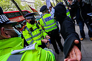 London, United Kingdom, May 11, 2021: Police stopped and searched one of the pro-Palestinian demonstrator outside Elbit System HQ in London meanwhile demonstrators are protesting against the killing of at least 24 Palestinians in Israeli air raids on the besieged Gaza Strip in central London on Tuesday, May 11, 2021. Demonstrators also continue to show their opposition against planned evictions of Palestinian families in the Sheikh Jarrah neighbourhood of East Jerusalem. This is the second week of ongoing protests to be held across England. (Photo/ Vudi Xhymshiti)