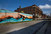 "Mural as a homage to Michaelangelo's Sistine Chapel in Rome painted on Grand Boulevard Detroit. Known as the world's traditional automotive center, ""Detroit"" is a metonym for the American automobile industry and an important source of popular music legacies celebrated by the city's two familiar nicknames, the Motor City and Motown. Many neighborhoods remain distressed since the collapse of the motor industry. The state governor declared a financial emergency in March 2013, appointing an emergency manager. On July 18, 2013, Detroit filed the largest municipal bankruptcy case in U.S. history."