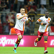Galatasaray's Burak Yilmaz (L) with Emmanuel Eboue celebrates his goal during their Turkish Super League soccer match Galatasaray between Eskisehirspor at the TT Arena at Seyrantepe in Istanbul Turkey on Saturday, 06 October 2012. Photo by TURKPIX