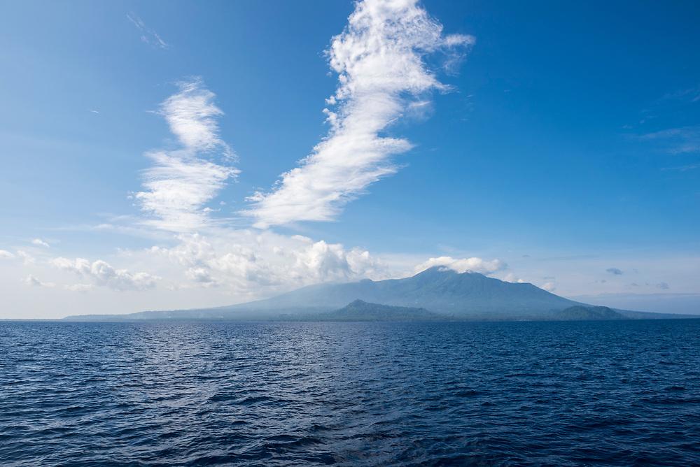 Tropical coastal scene at Karkar Island, a volcanic island in Madang Province, Papua New Guinea.