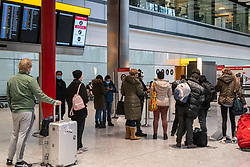 © Licensed to London News Pictures. 08/01/2021. London, UK. Passengers queue up at a Covid-19 Testing Centre at London Heathrow as Mayor of London, Sadiq Khan declares a Major Incident as cases continue to spread throughout the capital. This week, Prime Minister Boris Johnson plunged England into a 3rd lockdown as he ordered schools to close and workers to work from home as the government brings in the army to ramp up vaccinations across the country. Photo credit: Alex Lentati/LNP