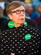 """01 FEBRUARY 2020 - DES MOINES, IOWA: RUTH SCHANKE. from Des Moines, wearing """"Amy Earrings"""" before a campaign event for US Senator Amy Klobuchar. Sen. Klobuchar campaigned to support her candidacy for the US Presidency Saturday in Iowa. She is trying to capitalize on her recent uptick in national polls. Iowa holds the first selection event of the presidential election cycle. The Iowa Caucuses are Feb. 3, 2020.     PHOTO BY JACK KURTZ"""