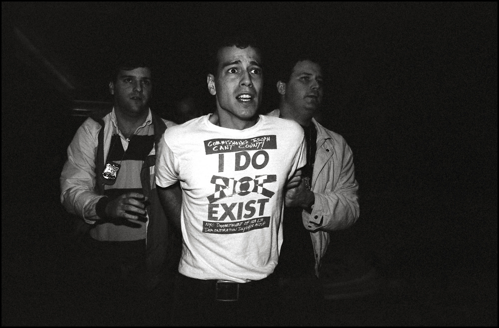 Scott Wald of ACT UP was arrested inside Trump Tower on On Oct. 31, 1989.  Roughly 100 protesters from ACT UP descended on Trump Tower at 5th Avenue and 56th Street. The Trump Tower protest was organized by ACT UP's Housing Committee, which hoped to draw attention to the lack of housing for homeless people with AIDS.