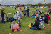 People watching the show jumping at the annual Suffolk Show on the 29th May 2019 in Ipswich in the United Kingdom. The Suffolk Show is an annual show that takes place in Trinity Park, Ipswich in the English county of Suffolk. It is organised by the Suffolk Agricultural Association.