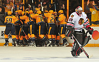 NASHVILLE, TN - APRIL 17:  Kevin Fiala #56 of the Nashville Predators is swarmed by teammates after scoring the game winning overtime goal against goalie Corey Crawford #50 of the Chicago Blackhawks in Game Three of the Western Conference First Round during the 2017 NHL Stanley Cup Playoffs at Bridgestone Arena on April 17, 2017 in Nashville, Tennessee.  (Photo by Frederick Breedon/Getty Images)