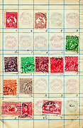 A collection of old stamps from Australia and Canada depicting King George V Philately is the study of postage stamps and postal history.