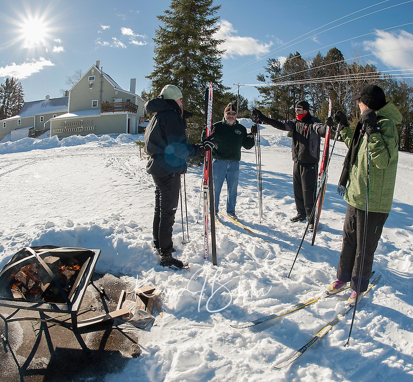 """Bob Bolduc explains the """"skate"""" skiing technique to Kelly and Mark Goodwin of Gilford and Liz Garlo of Concord during their first of a four week lesson program at Bolduc Park in Gilford on Saturday morning.   (Karen Bobotas/for the Laconia Daily Sun)"""