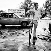 Disabled man in gas station, Florencia.<br />