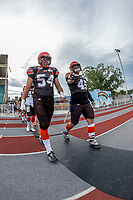KELOWNA, BC - AUGUST 17:   Cory MCCOY #54 and Aiden HENNESSEY #45 of Okanagan Sun walk to the field against the Westshore Rebels at the Apple Bowl on August 17, 2019 in Kelowna, Canada. (Photo by Marissa Baecker/Shoot the Breeze)