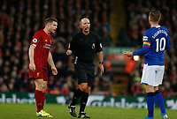 Football - 2019 / 2020 Premier League - Liverpool vs. Everton<br /> <br /> Rreferee Mike Dean has words with Gylfi Sigurdsson of Everton as James Milner of Liverpool looks on, at Anfield.<br /> <br /> COLORSPORT/ALAN MARTIN