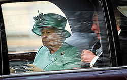 © Licensed to London News Pictures. 19/12/2019. London, UK. PRINCE CHARLES (R) and QUEEN ELIZABETH II (L) are seen being driven down The Mall on their way back to Buckingham Palace after the State Opening of Parliament. Photo credit: Ben Cawthra/LNP