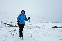 Female hiker in winter, Black Mountain, Brecon Beacons national park, Wales