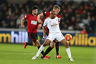 Andre Ayew of Swansea city holds off Darren Fletcher of West Bromwich Albion.  Barclays Premier league match, Swansea city v West Bromwich Albion at the Liberty Stadium in Swansea, South Wales  on Boxing Day Saturday 26th December 2015.<br /> pic by  Andrew Orchard, Andrew Orchard sports photography.