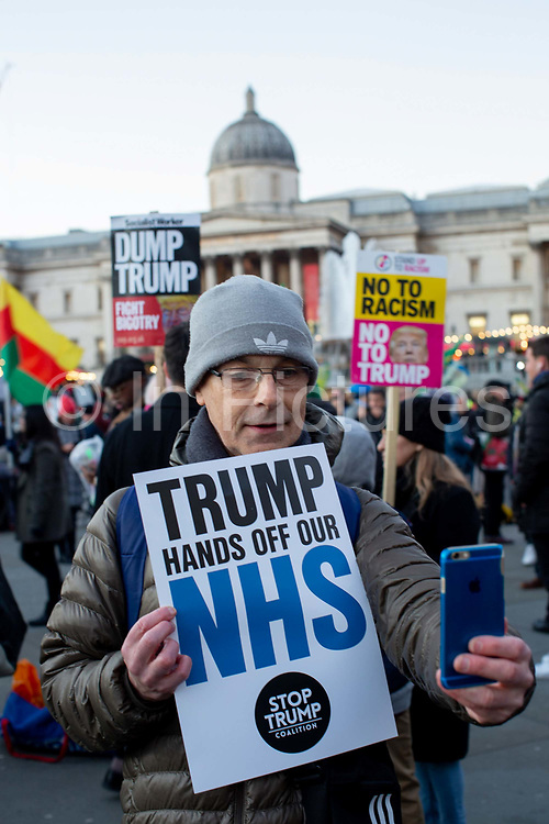 A man taking a selfie during the Stop Trump Coalition and CND protest against U.S. President Donald Trump UK visit to attend the NATO North Atlantic Treaty Organisation summit on the 3rd December 2019 in London in the United Kingdom. Ahead of a British national election on 12th December 2019, Stop Trump Coalition and CND, Campaign for Nuclear Disarmament organised a protest to target a banquet at Buckingham Palace where Trump will dine with the Queen and other NATO leaders. The U.K. is hosting NATO summit to mark the military alliances 70th anniversary.