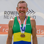 Simon Smith of Alexandra rowing for the Dunstan Arm Rowing Club with the bronze medal in the mens single scull <br /> <br /> Second day of finals races at the New Zealand Rowing Champs, Lake Karapiro, Cambridge Saturday 17 February 2018 Copyright photo © Steve McArthur /  Rowing NZ