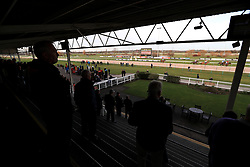 Racegoers watch the action in the first race of the day at Southwell Racecourse.