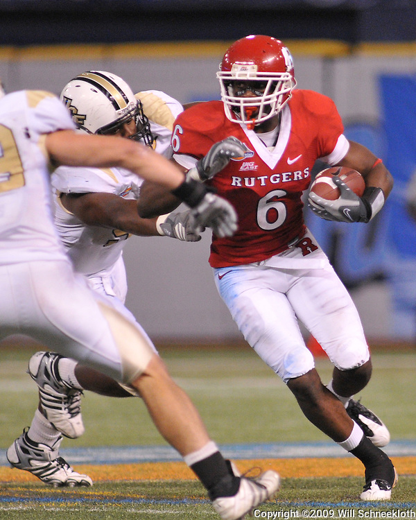 Dec 19, 2009; St. Petersburg, Fla., USA; Rutgers wide receiver Mohamed Sanu (6) runs through tackle attempts during NCAA Football action in Rutgers' 45-24 victory over Central Florida in the St. Petersburg Bowl at Tropicana Field.