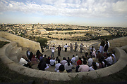 A tour group looks at the Old City as seen from the Mount of Olives, Jerusalem, Israel