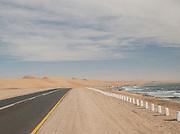 Coastal road running between the Namib Desert and the South Atlantic Ocean, Namibia