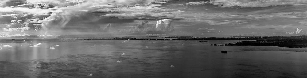 Karst islands of SW Misool, Raja Ampat, Papua Barat. Top RHS are Ceram's mountains, Maluku, Indonesia.