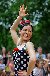 "© Licensed to London News Pictures. 27/05/2018. LONDON, UK.  A flamenco dancer entertains the crowds at ""Feria De Londres"", on the Southbank.  The three day festival held over the bank holiday weekend celebrates the culture of the Andalusian region of Southern Spain through dance, food and music.  Photo credit: Stephen Chung/LNP"