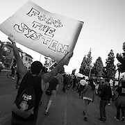"""Protesters on the streets of Los Angeles demonstrating against the decision in Ferguson, Missouri to not indict police officer in the shooting death of unarmed, black teenager Mike Brown. These Photographs And More Are Available in Color. Please Search for """"Ferguson"""""""