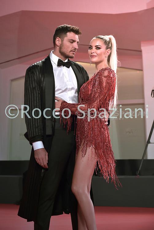 "VENICE, ITALY - SEPTEMBER 10: Luigi Mario Favoloso,Elena Morali walks the red carpet ahead of the movie ""Run Hide Fight"" at the 77th Venice Film Festival on September 10, 2020 in Venice, Italy.<br /> (Photo by Rocco Spaziani)"