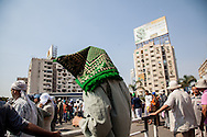 Muslim Brotherhood supporters form a checkpoint and security line around their sit-in in Nassr City, Cairo