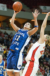 04 February 2006: Stephanie Lisch fades backwards into a defensive Holly Hallstrom and takes a shot.  The Indiana State Sycamores shook the Illinois State Redbirds from the nest with a 75-71 Victory.  There were 3,581 fans on hand, making the audience the  2nd largest women's basketball crowd ever in Redbird Arena on Illinois State University campus in Normal Illinois.