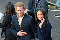 File photo dated 01/12/17 of Prince Harry and Meghan Markle arriving at the Nottingham Contemporary, on their first official engagement together. The showstopping royal event of the year will be the wedding of Prince Harry to American actress Meghan Markle on Saturday May 19.