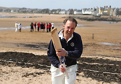 """A batsman leaves the """"field"""" after being hit out during the beach cricket match in Elie, between the Ship Inn cricket team, in Elie, Fife and Eccentric Flamingos CC .  The Ship Inn are the only pub in Britain to have a cricket team with a pitch on the beach. The Ship Inn CC season runs from May to September with dates of matches dependent on the tide. They play against a combination of regular opposition from Scotland and touring teams from all over the world. Any Batsman hitting a six which lands in the Ship Inn beer garden wins their height in beer and any non playing spectator who catches a six in the beer garden also wins their height in beer.PRESS ASSOCIATION Photo. Picture date:Sunday April 30, 2017. Photo credit should read: Andrew Milligan/PA Wire."""
