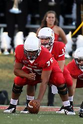 21 September 2013:  Blake Winkler under center Charles Cowley during an NCAA football game between the Abilene Christian Wildcats and the Illinois State Redbirds at Hancock Stadium in Normal IL