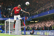 Manchester United Midfielder Ashley Young heads the ball clear during the The FA Cup 5th round match between Chelsea and Manchester United at Stamford Bridge, London, England on 18 February 2019.