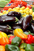 Israel, Fresh vegetable stall in a market with eggplant, bell peppers and lemons