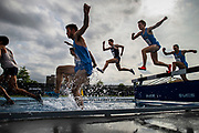 A crowd of runners compete in the Men's Steeplechase during the first day of the Big East Outdoor Track & Field Championships held at Icahn Stadium located on Randalls Island in New York, New York on May 10, 2019.
