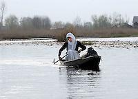 A Kashmiri girl makes her way home on the Srinagar Lake in Kashmir, India.
