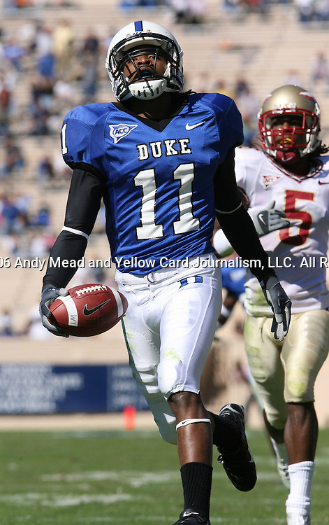 14 October 2006: Duke's John Talley (11), chased by Florida State's Chris Davis (5), runs an interception back 50 yards for a touchdown in the second quarter. The Florida State University Seminoles defeated the Duke University Blue Devils 51-24 at Wallace Wade Stadium in Durham, North Carolina in an Atlantic Coast Conference NCAA Division I College Football game.