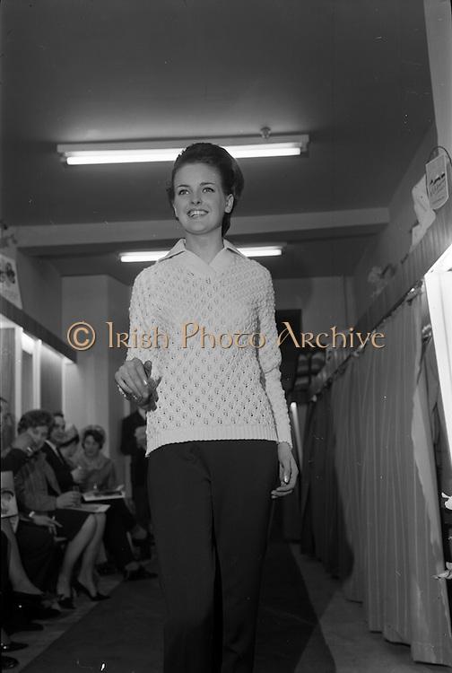09/04/1964<br /> 04/09/1964<br /> 09 April 1964<br /> Fashion show at Woolcraft Fashion Week at Creation Arcade, Grafton Street, Dublin. Woolcraft Ltd showcase of Alpine Knitwear and Carina Jerseywear. Model wearing design.
