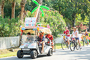 Golf cart floats decorated in tropical style during the annual Independence Day parade July 4, 2019 in Sullivan's Island, South Carolina. The tiny Sea Island beach community across from Charleston, was once a quarantine station for enslaved Africans, and is now one of the most affluent, least diverse communities with one of highest per capita real estate costs in the United States.
