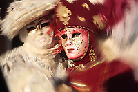 wonderful fashion show of disguised people during the venice carnival in italy<br /> (the effect is not a photoshop trick)