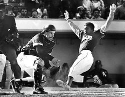 Oakland A's Tony Phillips beats the throw to San Francisco Giants  catcher Bob Brenly and scores the winning run in the bottom of the 9th inning. (1983 photo by Ron Riesterer)