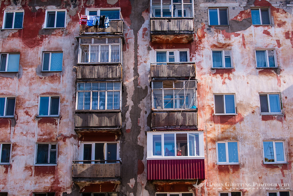Russia, Sakhalin, Yuzhno-Sakhalinsk. An old Soviet era apartment block.