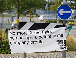© Licensed to London News Pictures. 10/09/2013. London, UK. A banner erected by protesters is seen outside the Defence Security and Equipment International (DSEI) exhibition in London today (10/09/2013). The biennial event, held at the at the Excel Centre in London's Docklands, is one of the world's largest with around 1350 exhibitors from 40 countries across the world. Photo credit: LNP