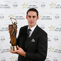 8 November 2013; Clare hurler Brendan Bugler with his 2013 GAA GPA All-Star award, sponsored by Opel, at the 2013 GAA GPA All-Star awards in Croke Park, Dublin. Picture credit: Paul Mohan / SPORTSFILE *** NO REPRODUCTION FEE ***