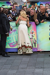 Leicester Square, London, August 3rd 2016. Hundreds of fans greet the stars of Suicide Squad at the film's European premiere in London's Leicester Square. Stars attending include: Jared Leto, Joel Kinnaman, Jai Courtney, Jay Hernandez, Adewale Akinnuoye-Agbaje, Cara Delevingne, Karen Fukuhara David Ayer (Director) Richard Suckle and Charles Roven (Producers). PICTURED: Margot Robbie