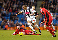 Photo: Leigh Quinnell.<br /> West Bromwich Albion v Coventry City. Coca Cola Championship. 16/12/2006. West Broms Diomansy Kamara skips past Coventrys Robert Page(L) and Richard Duffy.